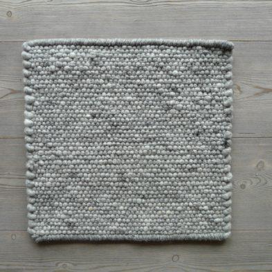 Gewebte Sitzauflage aus reinem Wollfilz